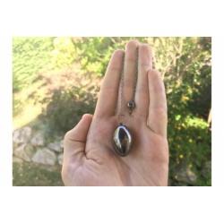 Pendulum egg with black stone inside